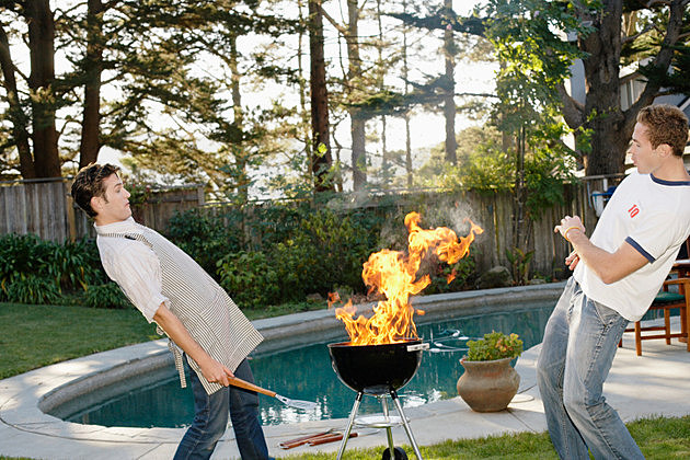 men and grill - Barbecue and Fire Pit Safety for the Summer