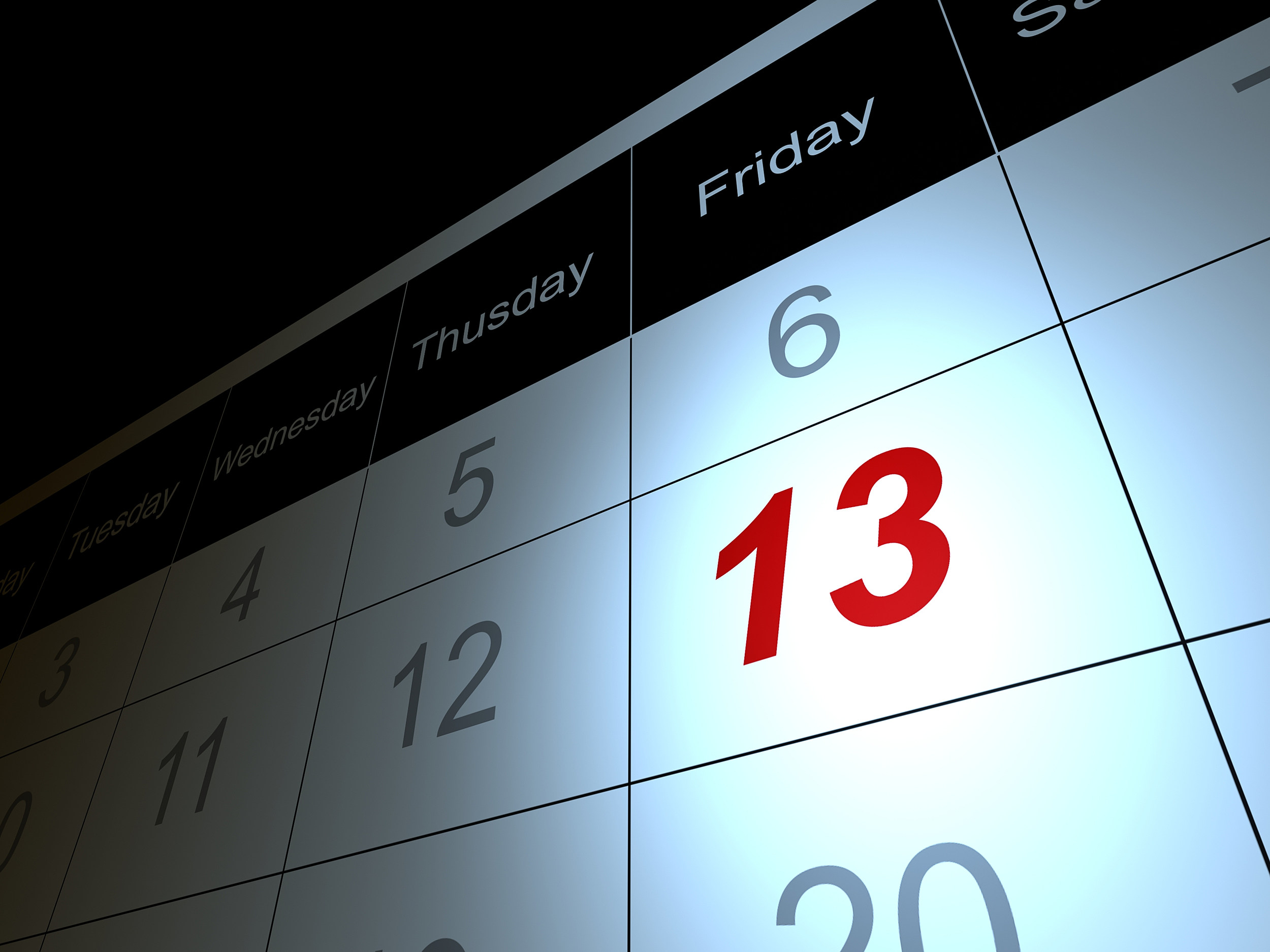 Friday the 13 date in red on calendar