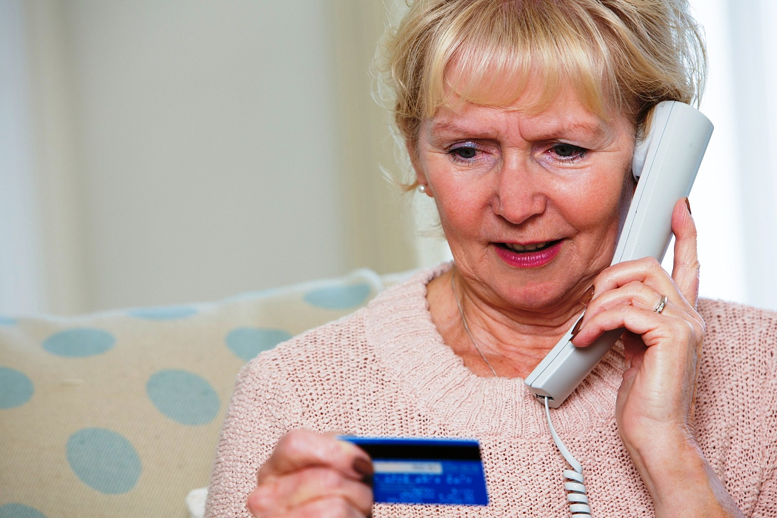 Woman on Phone Giving Out Credit Card Number